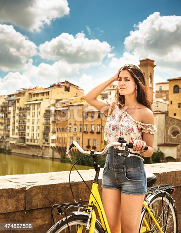 969439086 istock photo tourist biking in Florence 474867526