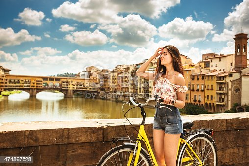 969439086 istock photo tourist biking in Florence 474867528