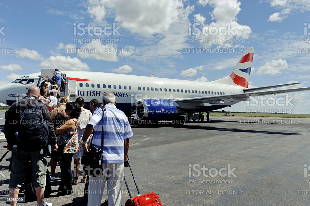 Tourist boarding British Airways Boeing 737-300, Victoria Falls,Zimbabwe stock photo