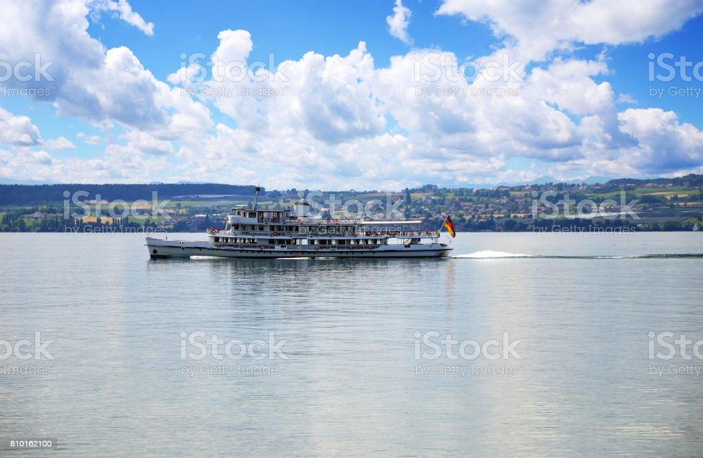 Tourist boat at Lake Constance with blue sky and small clouds at far horizon stock photo
