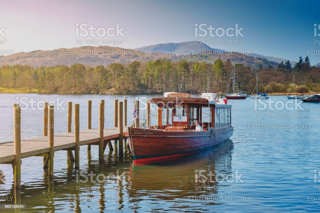 Tourist boat cruise at Waterhead Pier in Ambleside, a lakeside town situated at the head of Windermere Lake within the Lake District National Park in England stock photo