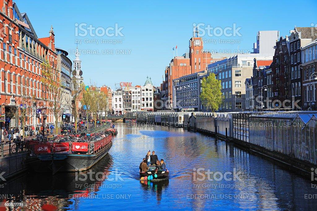 Tourist boat in Amsterdam canal, Netherlands zbiór zdjęć royalty-free