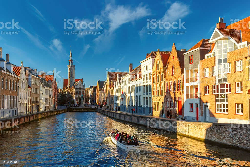 Tourist boat on canal Spiegelrei, Bruges, Belgium stock photo