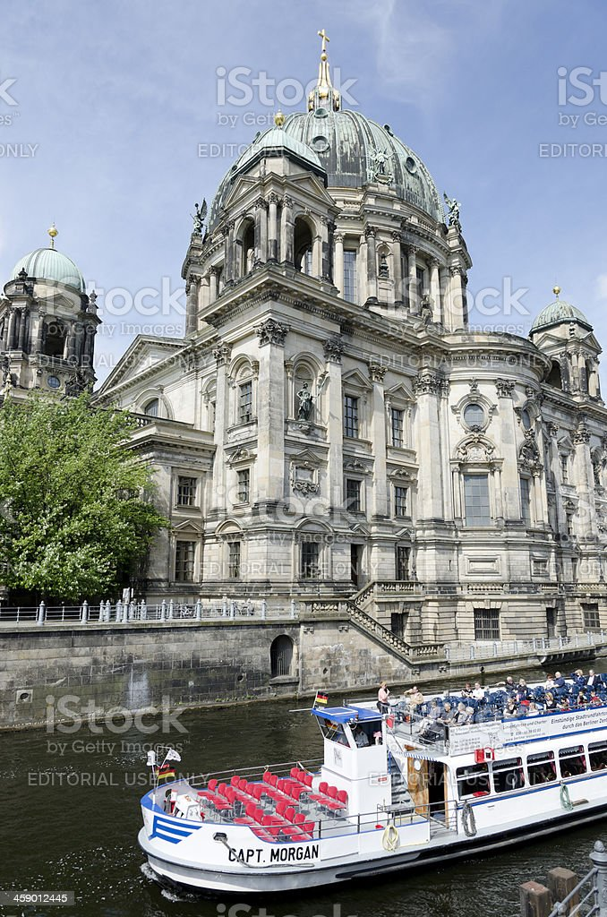 Tourist boat on Spree River with Berlin Cathedral royalty-free stock photo
