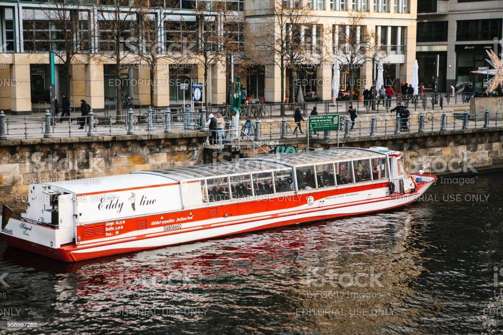 Tourist boats cruise along the river Spree in Berlin, past sights stock photo