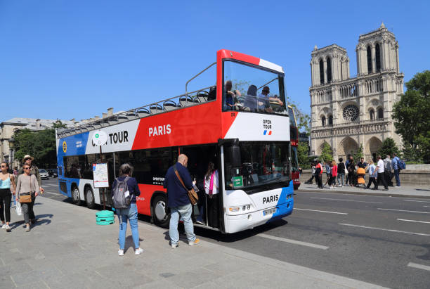 Tourist bus at the Notre Dame in Paris, France stock photo