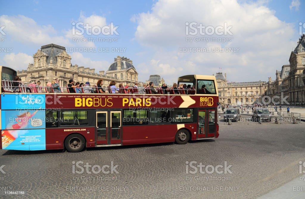 Tourist bus drives past the Louvre in Paris, France stock photo