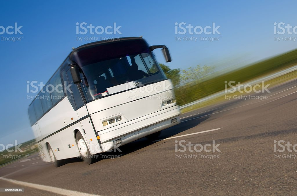 Tourist bus on the road with blurred background stock photo