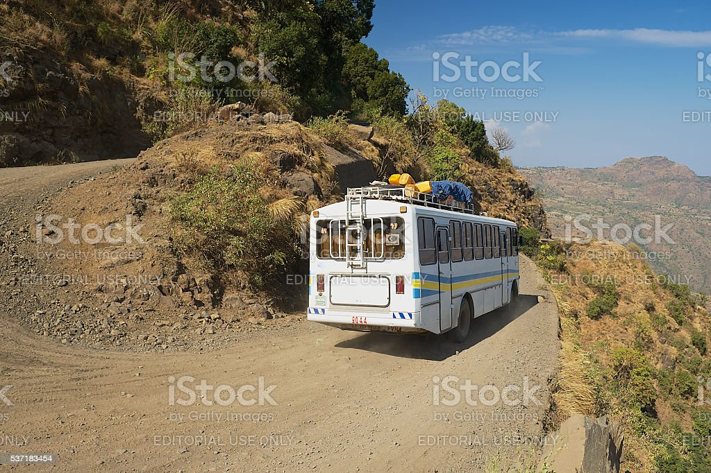 Tourist bus passes by the mountain road in Axum, Ethiopia. stock photo