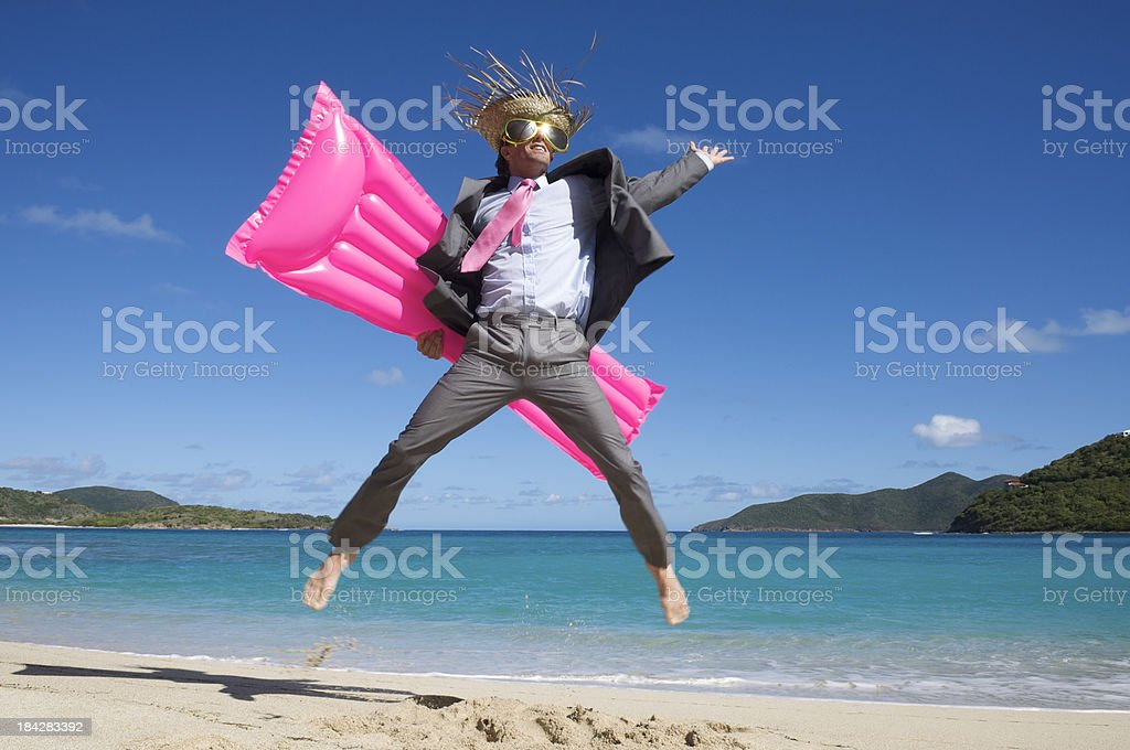 Tourist Businessman Does a Big Jump with Pink Air Mattress stock photo
