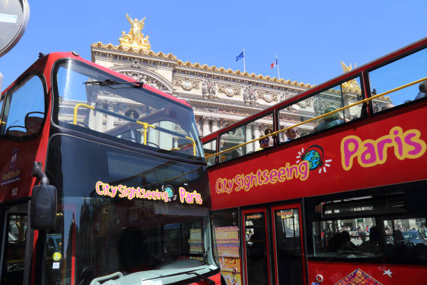 Tourist busses at the Opera building in Paris, France stock photo