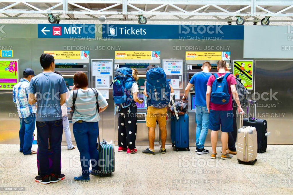 Tourist buying a ticket Machine (GTM) in Singapore stock photo