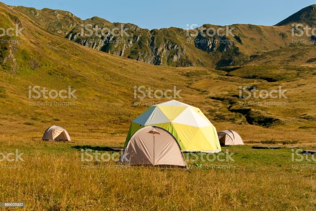 tourist camp in the mountain valley stock photo