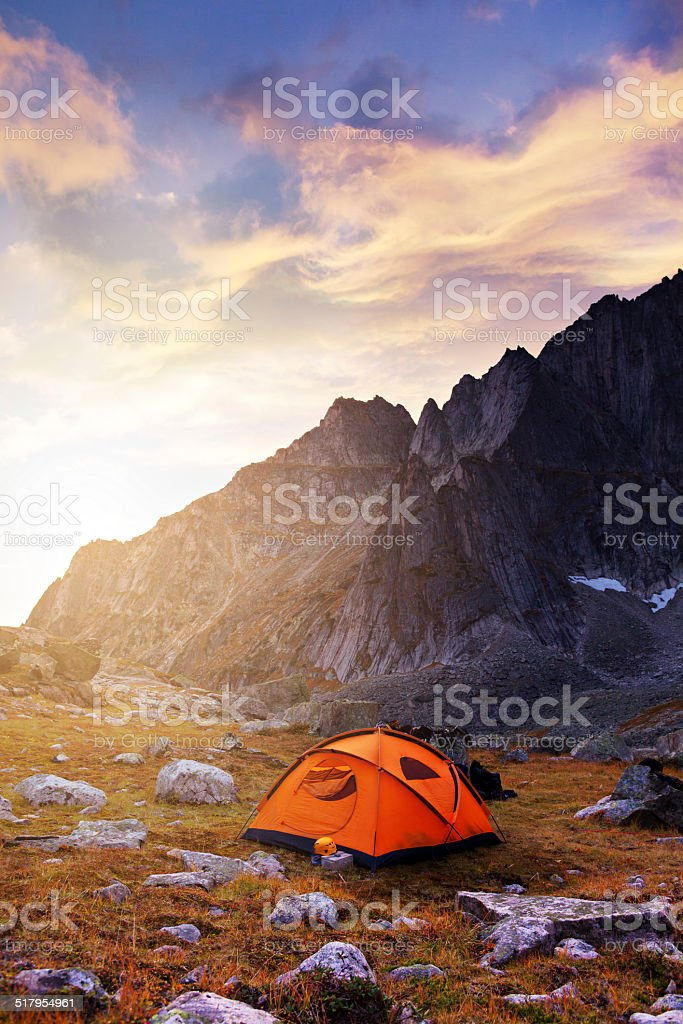 Tourist camping in the mountains stock photo
