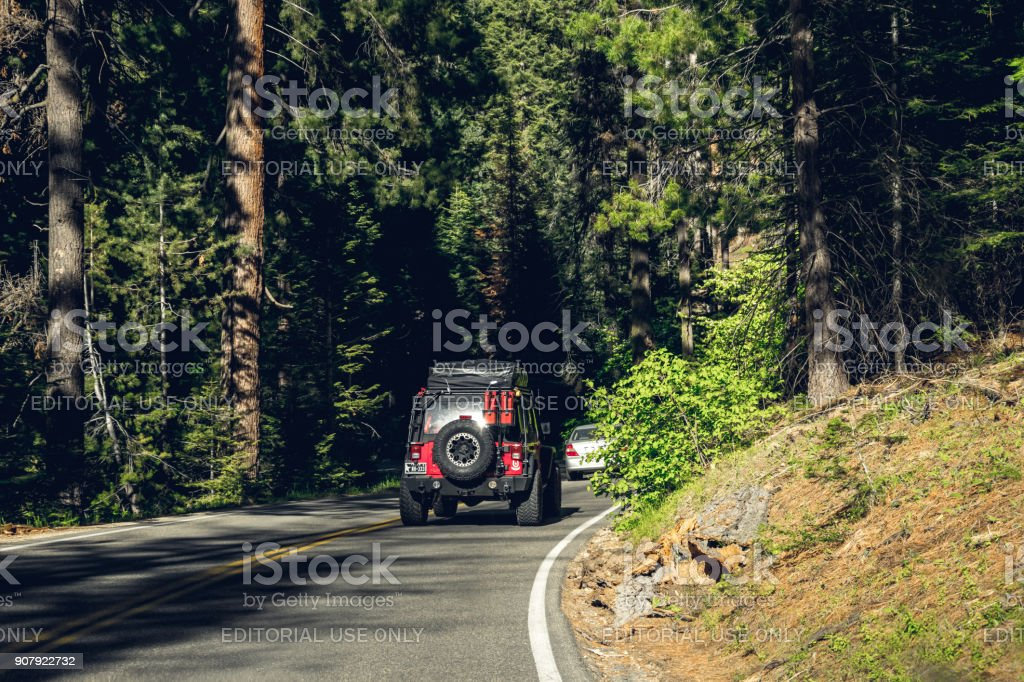 Tourist car Jeep Wrangler on the highway in Sequoia National Park, California, USA stock photo