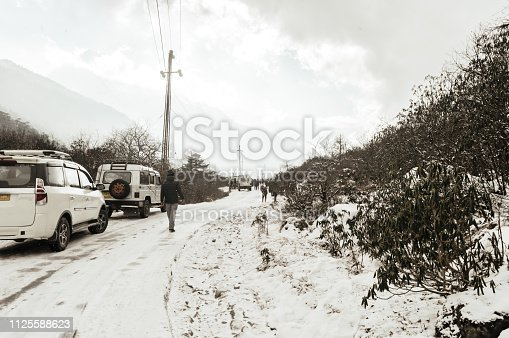 Gangtok, Sikkim, 1st Jan 2019: Tourist cars halts during snow fall and slippery road on the way to zero point at an altitude of 15,300 ft and about 23 kms from Yumthang.