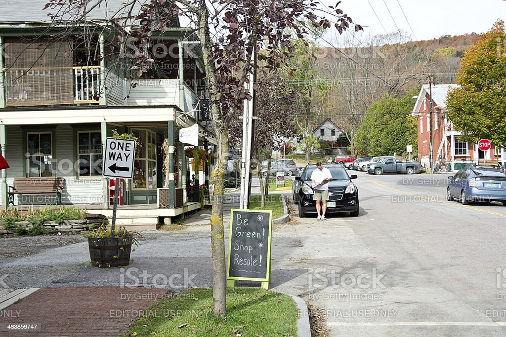 Tourist checking map in Waitsfield, Vermont stock photo