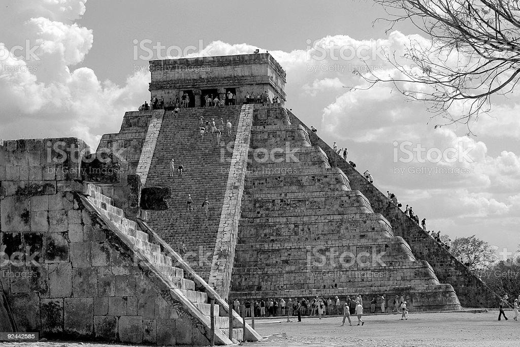 Tourist climbing main pyramid in Chichen Itza, Mexico royalty-free stock photo
