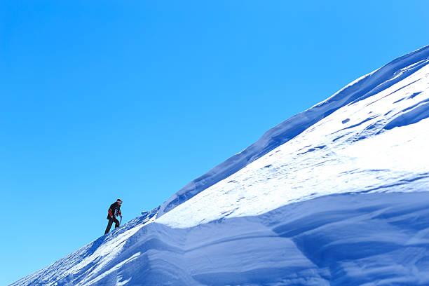 Tourist climbing up in Bansko ski resort, Bulgaria stock photo