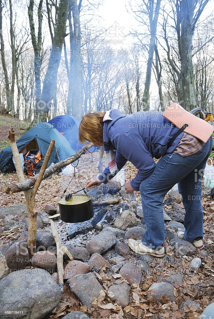 Tourist cooking on the campfire. stock photo