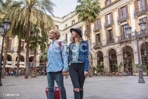 Tourist couple in city centre square Barcelona