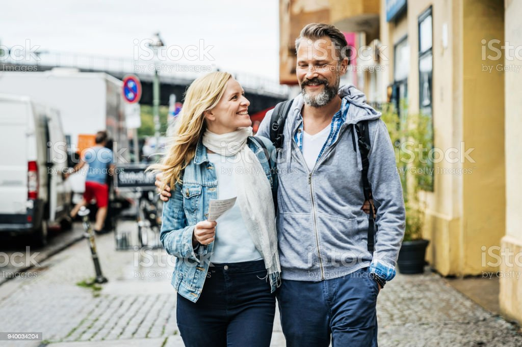 Tourist Couple Embrace While Out Exploring The City stock photo
