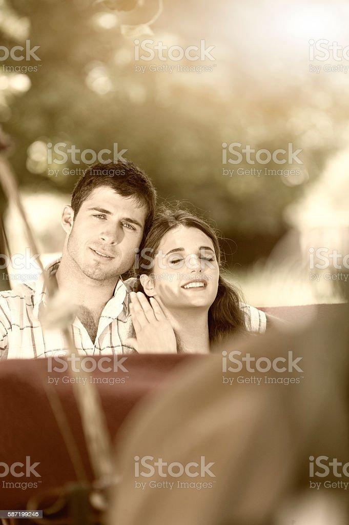 Tourist couple enjoying a ride stock photo