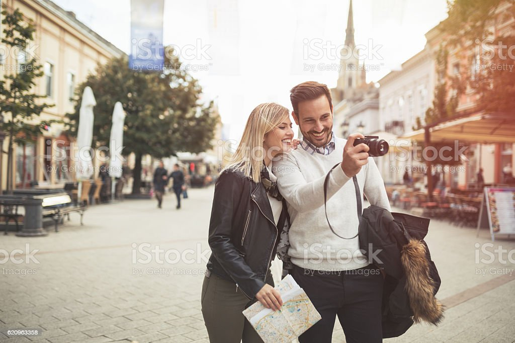 Tourist couple enjoying sightseeing stock photo