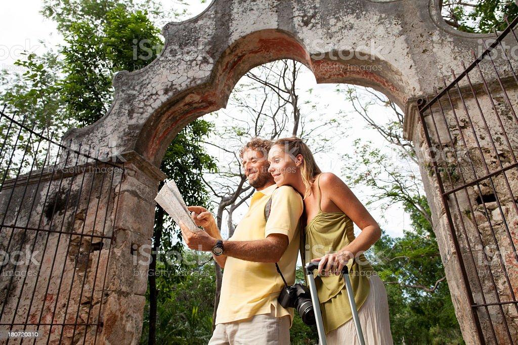 Tourist couple exploring royalty-free stock photo