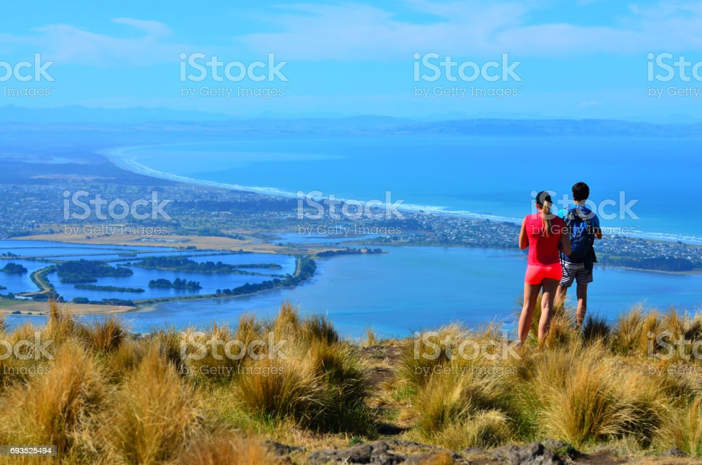 Tourist couple look at the landscape view of Christchurch - New Zealand stock photo