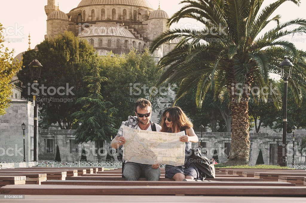 Tourist couple reading map and traveling in Istanbul stock photo