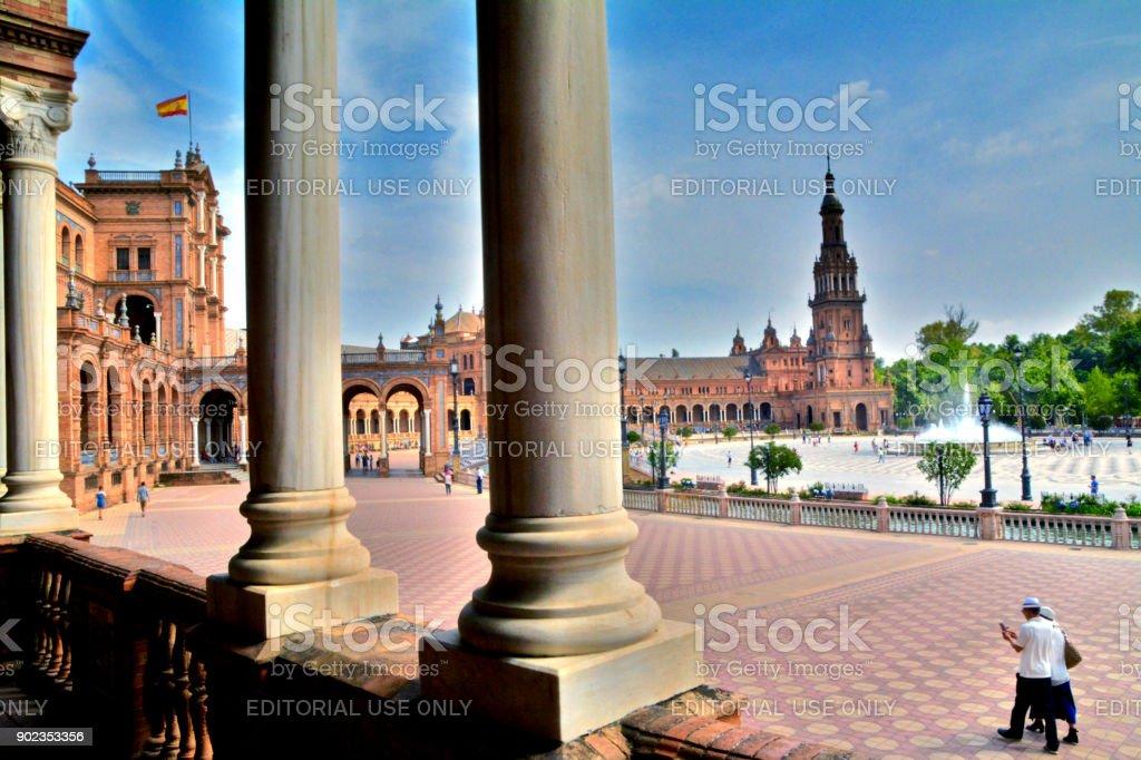 Tourist Couple Stroll through the Seville Expo Hot Summer Day stock photo