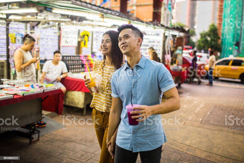 Tourist couple walking at the Jalan Petaling market, royalty-free stock photo