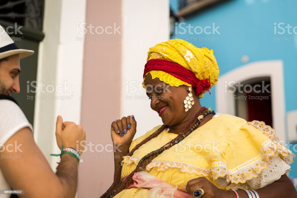 Tourist dancing with local Brazilian woman 'Baiana' in Pelourinho, Salvador, Bahia, Brazil stock photo