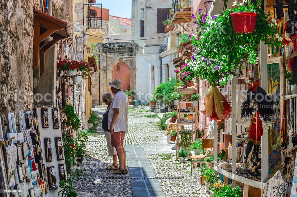 Tourist duo in Old Town of Rhodes, Greece stock photo