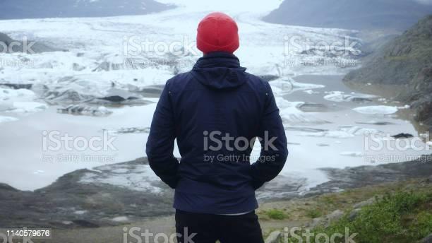 Tourist enjoying amazing view. Admiring glacier lagoon