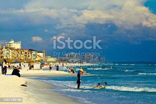 1054156720istockphoto Tourist enjoying at Destin Beach Florida 1054199196