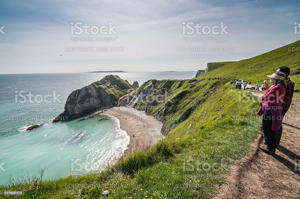 Tourist enjoying beautiful scenery at the Jurassic Coast, Dorset, England stock photo