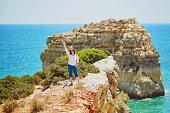 Tourist enjoying scenic landscape in Algarve, Portugal