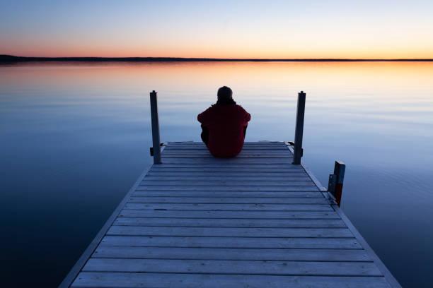 Tourist Enjoying The Sunset Prince Albert National Park Saskatchewan Canada stock photo