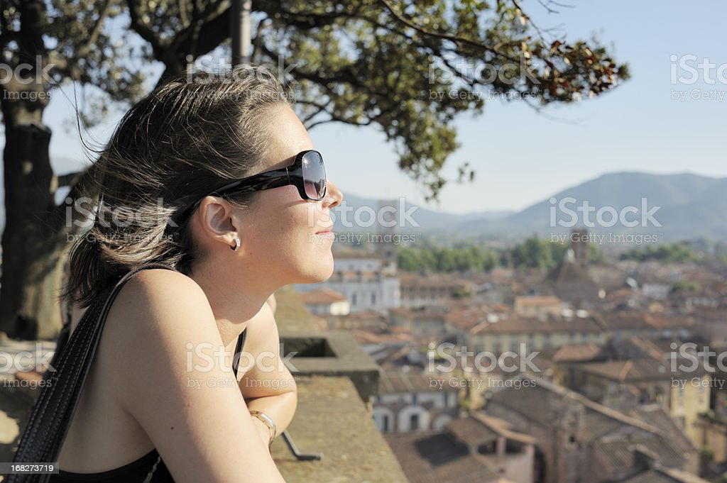 Tourist Enjoys the View from Torre dei Guinigi royalty-free stock photo
