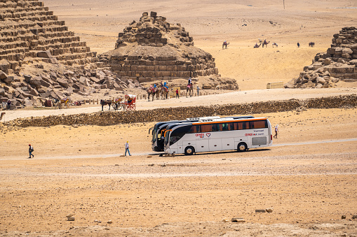 CAIRO, EGYPT - MAY 18 2021: tourist excursion bus of the tour operator Anex Tour, brought tourists to the pyramids of Giza. Tourism and travel in Egypt. Resuming international travel