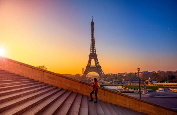 Tourist exploring Eiffel Tower Paris France stock photo