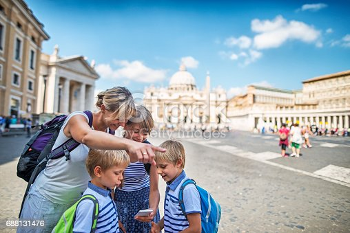 istock Tourist family checking directions near St. Peter's Square, Rome, Italy 688131476