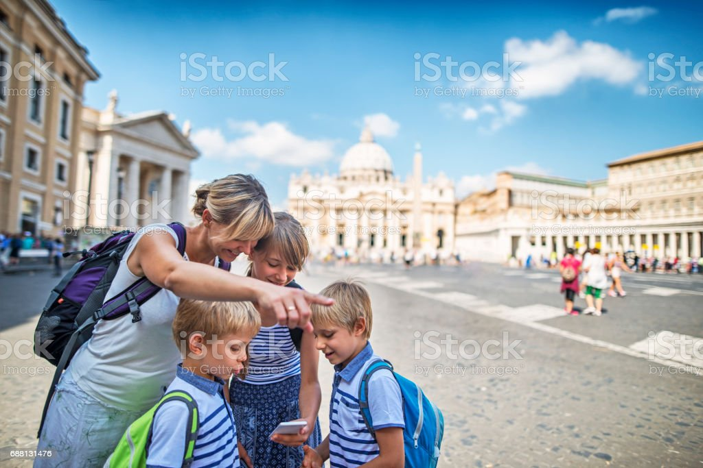 Tourist family checking directions near St. Peter's Square, Rome, Italy stock photo