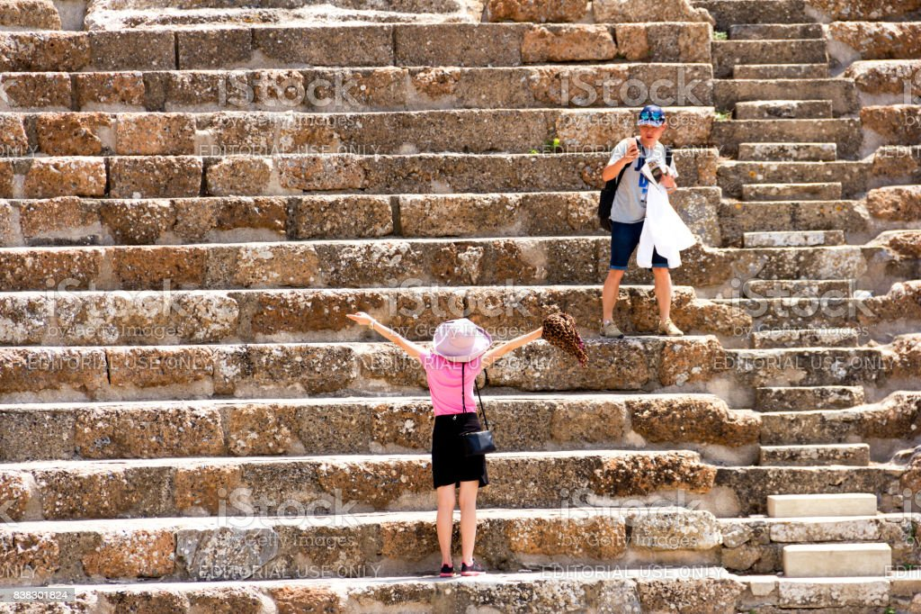 A Tourist Family Is Inside Of The Ephesus Amphitheatre stock photo