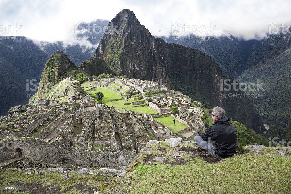 Tourist gazing at classic view of Machu Picchu royalty-free stock photo