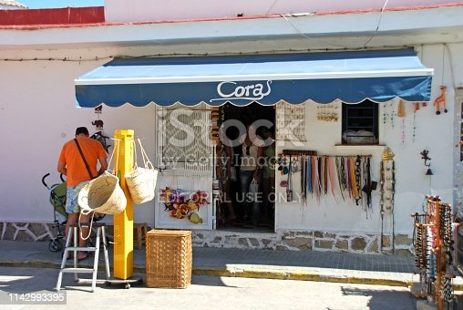 Tourists at a local town gift shop, Zahara de los Atunes, Cadiz Province, Andalusia, Spain, Europe.