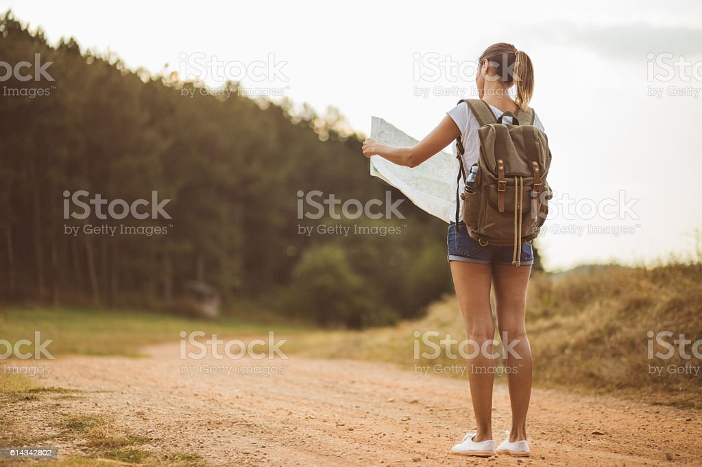 Tourist Girl Checking Out Locatig Map stock photo