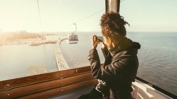 Tourist girl in cableway car stock photo